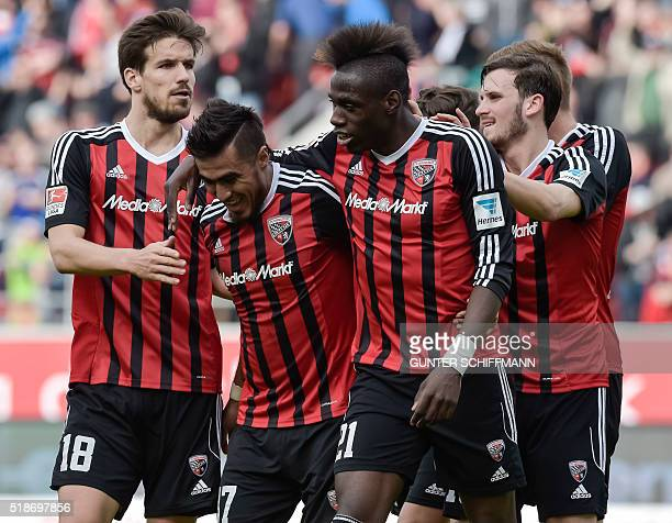 Ingolstadt's Paraguayan forward Dario Lezcano celebrates with teammates after scoring his team's third goal during the German first division...