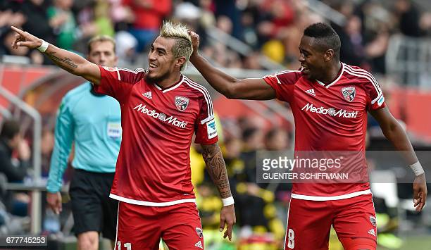 Ingolstadt's Paraguayan striker Dario Lezcano celebrates scoring with Ingolstadt's Brazilian midfielder Roger de Oliveira Bernardo during the German...