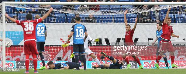 Ingolstadt's players celebrate the 12 by own goal during the German First division Bundesliga football match between TSG Hoffenheim and FC Ingolstadt...