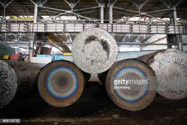 Ingot of titanium alloy sit after melting in a vacuum arc furnace at the VSMPOAVISMA Corp plant in Verkhnyaya Salda Russia on Monday May 14 2018 The...