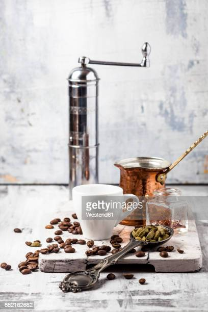 ingredients and accessories for preparing arabian coffee - coffee grinder stock photos and pictures