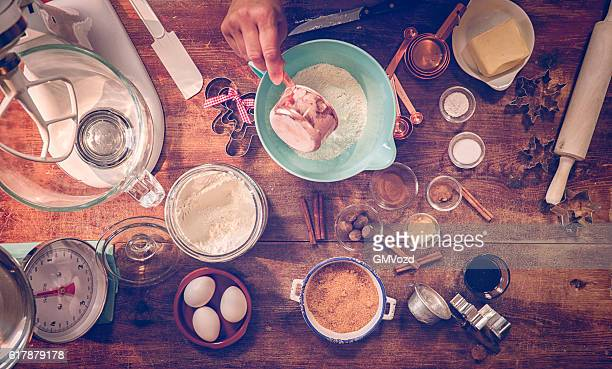 ingredients and baking utensils for baking christmas cookies - cooking utensil stock photos and pictures