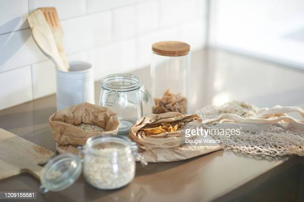 ingredients and wooden utensils in plastic free zero waste kitchen. - oats food stock pictures, royalty-free photos & images