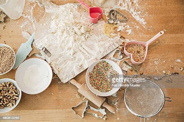 Ingredients, baking mold, bowls, rolling pin, sieve