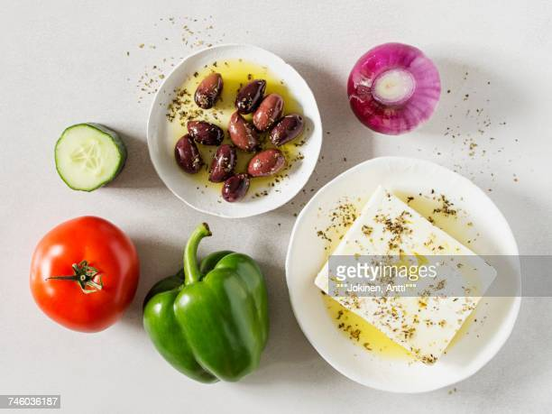 ingredients for a greek country salad (horiatiki, greece) - olive pimento stock photos and pictures