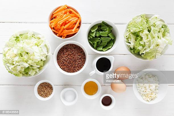 Ingredients for a wok dish with red rice