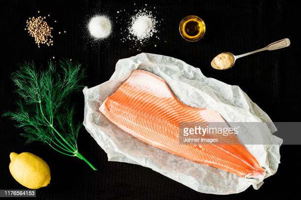 ingredients for baked salmon on black background - 鮭料理 ストックフォトと画像