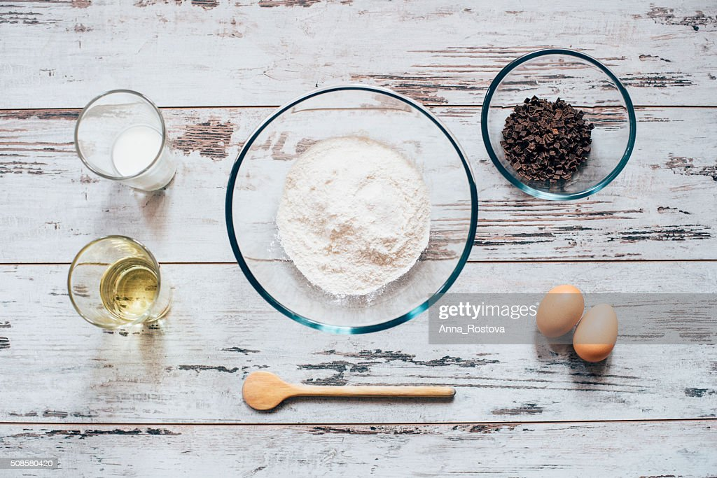 Ingredients for baking of muffins on wooden table : Stock Photo
