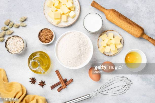 ingredients for baking on white table - 小麦粉 ストックフォトと画像
