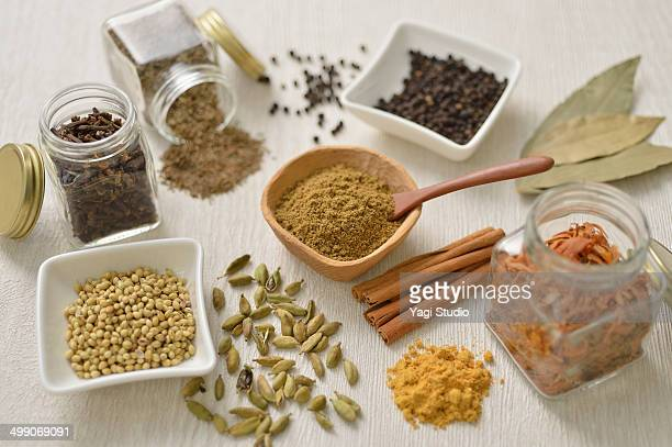 ingredients for garam masala - garam masala stock photos and pictures