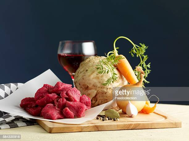 ingredients for goulash with celeriac and carrots - celeriac stock photos and pictures
