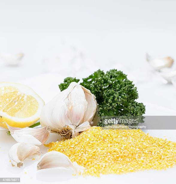 ingredients for gremolata and polenta - heinz baumann photography stock-fotos und bilder