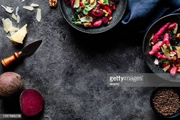 ingredients for making beetroot pasta - kitchen worktop stock pictures, royalty-free photos & images