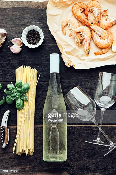 ingredients for pasta dish with prawns, tomatoes and white wine - things that go together stock photos and pictures