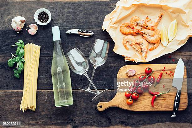 Ingredients for pasta dish with prawns, tomatoes and white wine