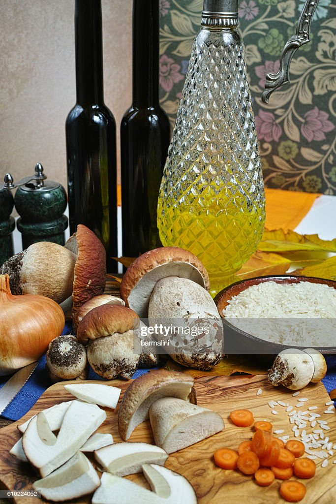 Ingredients for risotto with wild mushrooms boletus : Stock Photo