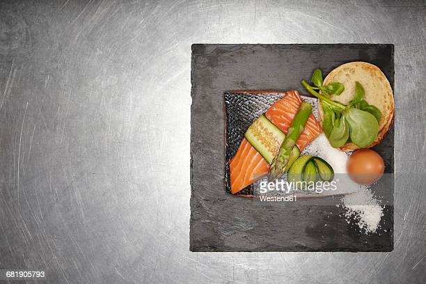 Ingredients for salmon burger with egg, cucumber and asparagus