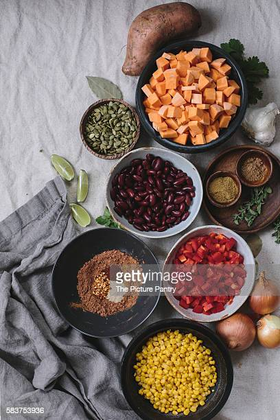 Ingredients for Sweet Potato and Corn Chocolate Chili are photographed from the top.