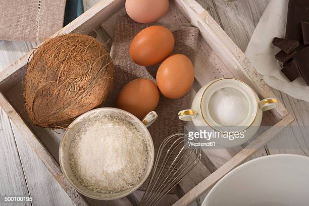 ingredients of coco macaroons on wooden tray, elevated view - sugar bowl crockery stock photos and pictures