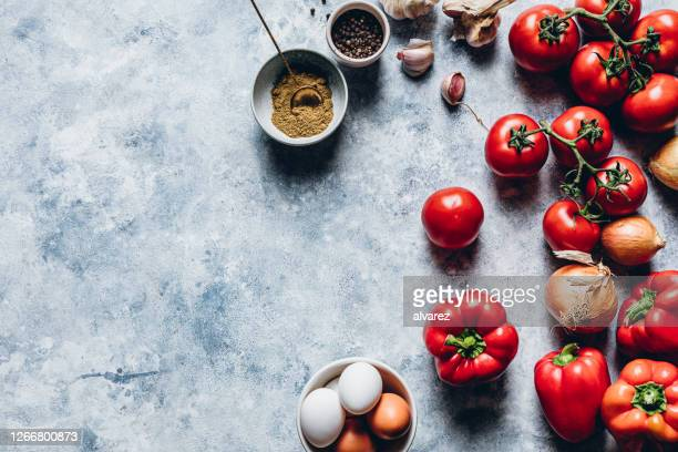 ingredients of shakshuka on kitchen counter - tomato stock pictures, royalty-free photos & images