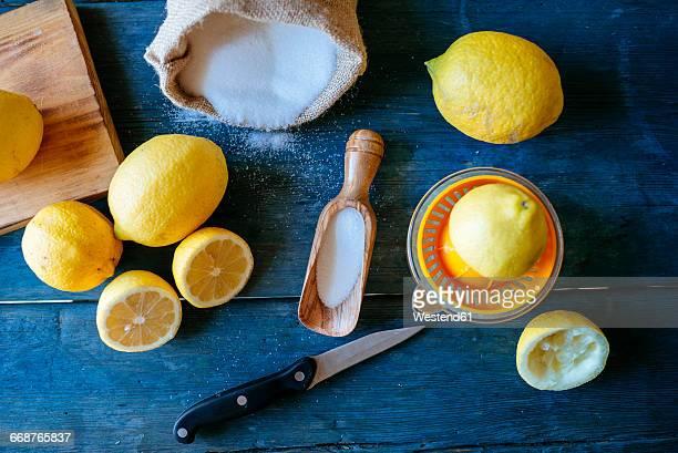 Ingredients to make lemonade on blue wood