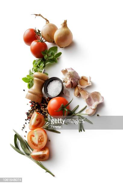 ingredients: tomatoes, onions, garlic, oregano, rosemary, salt and pepper isolated on white background - ingredient stock pictures, royalty-free photos & images