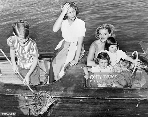 Ingrid and Children on Boat Outing. Santa Marinella, Italy: Actress Ingrid Bergman and her four children are enjoying a holiday at her seaside villa...