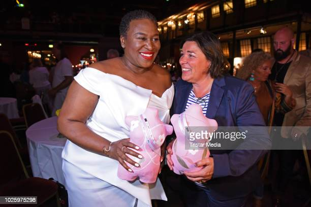 Ingrid Arthur and Vera IntVeen pose with their awards during the plus size model award show 'Fraeulein Kurvig' at Kunstwerk Moechengladbach on...