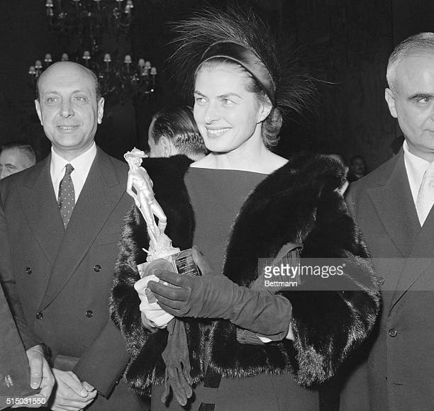 Ingrid Awarded Italian David Rome Italy Actress Ingrid Bergman smiles warmly with her golden David Italy's version of the Hollywood Oscar which she...