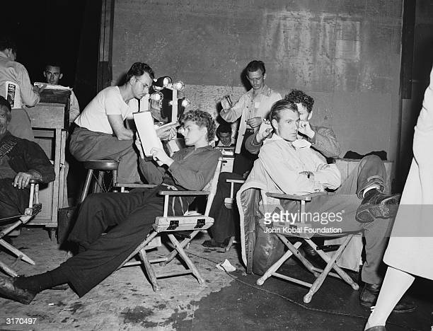 Ingrid Bergman and Gary Cooper relax during the filming of 'For Whom The Bell Tolls'