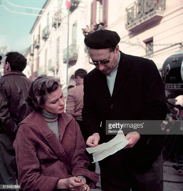 Ingrid Bergman and husband director Roberto Rossellini go over script before shooting the next scene in their latest film New Wine which also costars...