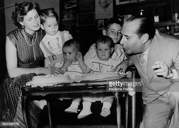 Ingrid Bergman and Roberto Rossellini celebrate the first birthday of their twin daughters Isabella and Isotta with their son Robertino and...