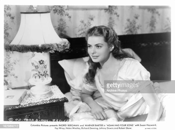 Ingrid Bergman lies in bed in a scene from the film 'Adam Had Four Sons' 1941