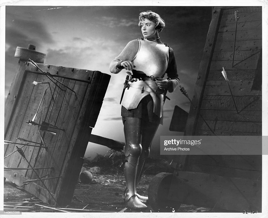 Ingrid Bergman Standing In Suit Of Armor Surrounded By Shot Arrows A Scene From The