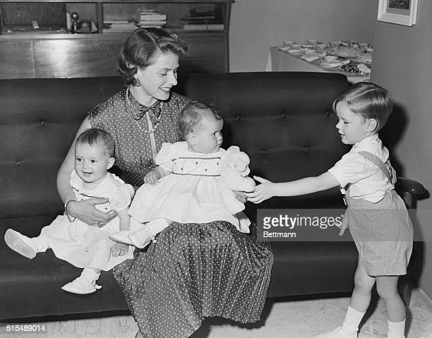 Ingrid Bergman with her children on the occasion of the first birthday of her twin daughters Isotta and Isabella in 1953 Her son Robertino is playing...