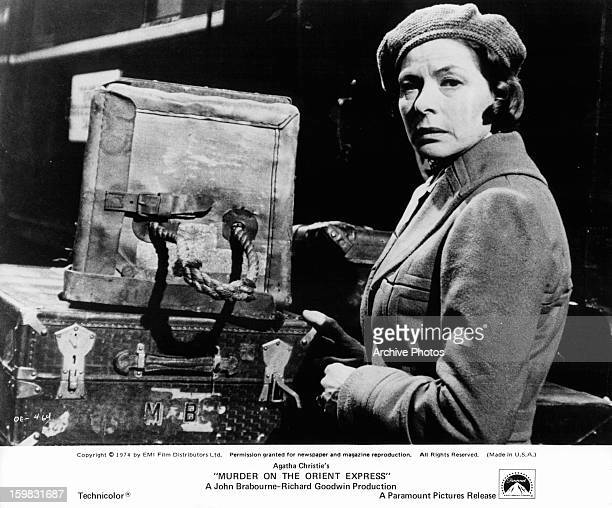 Ingrid Bergman with her luggage in a scene from the film 'Murder On The Orient Express', 1974.