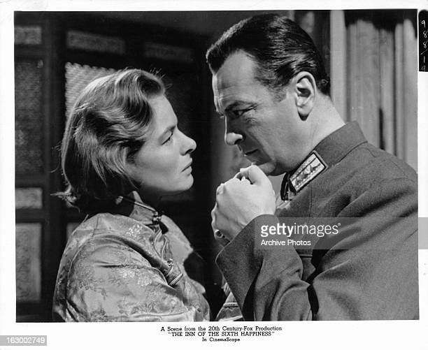 Ingrid Bergman's hand is held by Curd Jürgens in a scene from the film 'The Inn Of The Sixth Happiness', 1958.