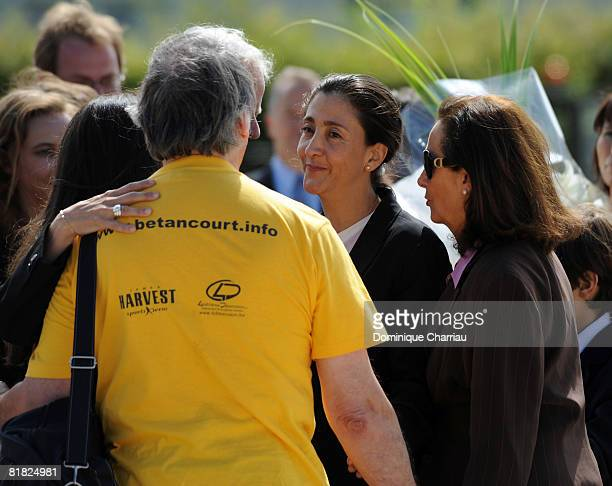 Ingrid Betancourt looks at an unidentified member of her support committee during the arrival ceremony at military base of Villacoublay on July 4,...