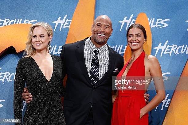 Ingrid Bolso Berdal Dwayne Johnson and Irina Shayk attend the Europe premiere of Paramount Pictures 'Hercules' at CineStar on August 21 2014 in...