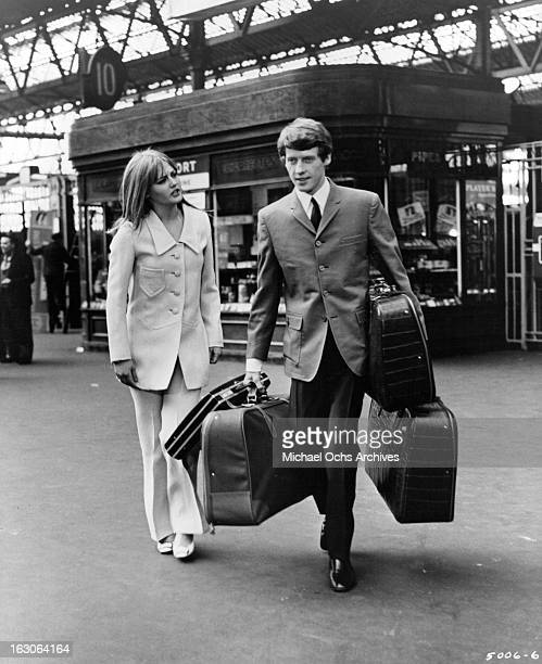 Ingrid Boulting greets Michael Crawford in a scene from the film 'The Jokers' 1967