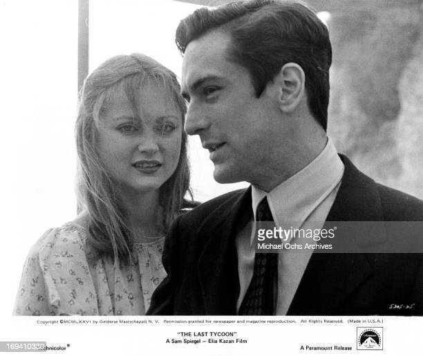 Ingrid Boulting standing behind Robert De Niro in a scene from the film 'The Last Tycoon' 1976