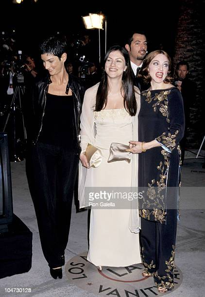 Ingrid Caseres Madonna and guests during 1999 Vanity Fair Oscar Party Arrivals at Morton's Restaurant in Los Angeles California United States