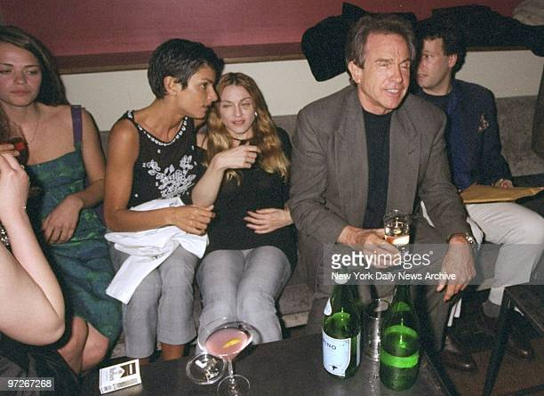Ingrid Cesares and Madonna share a seat with Warren Beatty at party celebrating the premiere of movie Two Girls and a Guy at the Moomba restaurant