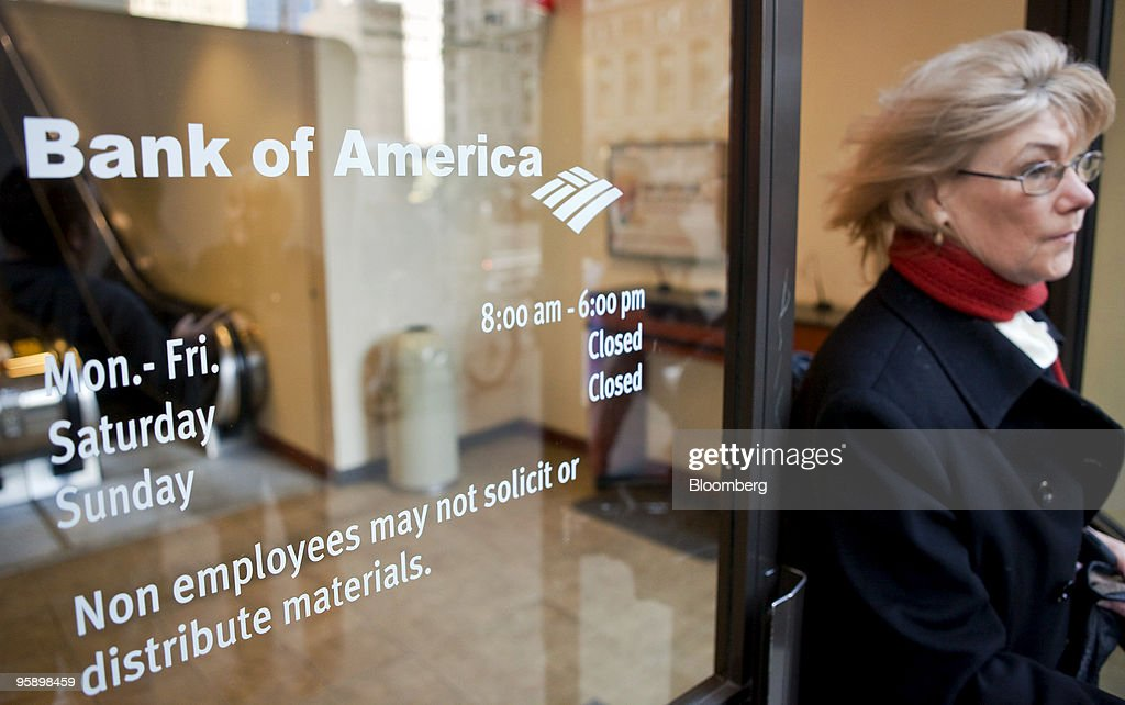 Ingrid Davidsen leaves a Bank of America branch in New York, U.S., on Wednesday, Jan. 20, 2010. Bank of America Corp., the largest U.S. lender, posted a quarterly loss and its first full-year deficit in more than two decades, driven by the cost of repaying U.S. bailout money and defaults on consumer loans. Photographer: JB Reed/Bloomberg via Getty Images