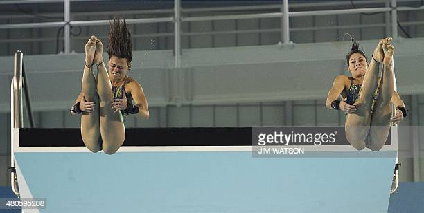 Ingrid De Oliveira and Giovanna Pedroso of Brazil compete in the Women's Synchronized 10M Platform finals at the 2015 Pan American Games in Toronto...
