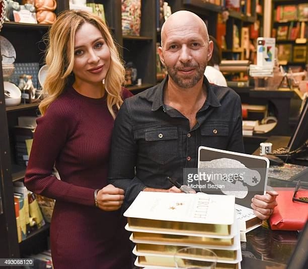 Ingrid DeLeo and Neil Strauss at the Neil Strauss Truth Book Signing at Book Soup on October 16 2015 in West Hollywood California