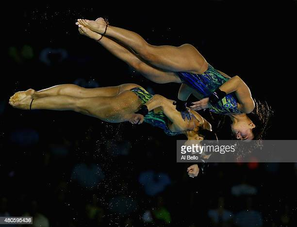 Ingrid DeOliveira and Giovanna Pedroso of Brazil dive at the Pan am Games during the Women' Synchronised 10m Platform Final at the Pan Am Games on...
