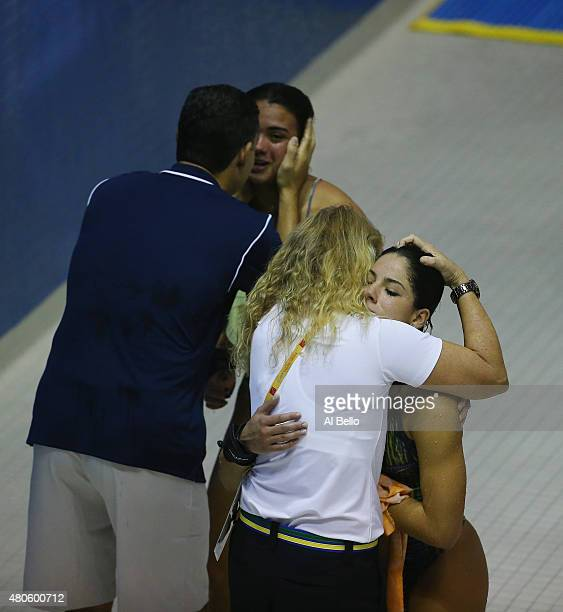 Ingrid DeOliveira and Giovanna Pedroso of Brazil react after fininshing in second place at the Pan am Games after the Women' Synchronised 10m...