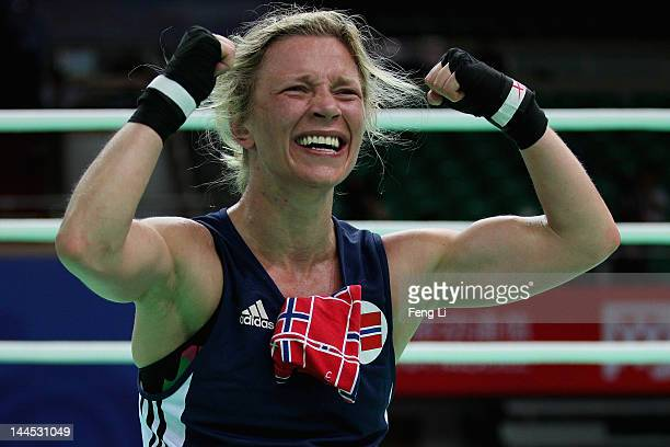 Ingrid Egner of Norway celebrates winning against Quanitta Underwood of the United States in the Women's 60kg preliminary match during the AIBA...