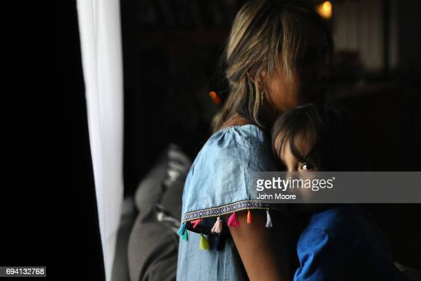 Ingrid Encalada an undocumented immigrant from Peru and mother of two holds her son Anibal Jurado 17 months at their home on June 6 2017 in Thornton...